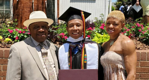Morehouse grad Ahmad Smith, flanked by his father, Wayne, and his sister Chanel, had $110,000 in student loans wiped clean. (Courtesy of Chanel Smith)