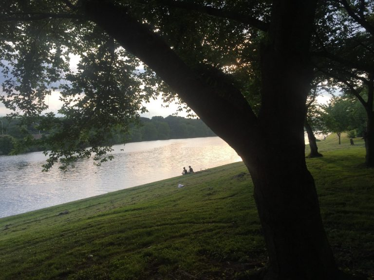 The Schuylkill river at dusk in Philadelphia. The river is a popular fishing spot. In 2018, the New Jersey DEP began testing fish for the family of chemicals known as PFAS and issued fish advisories. New Jersey has stricter limits on PFAS exposure than Pennsylvania. (Susan Phillips/StateImpact Pennsylvania)