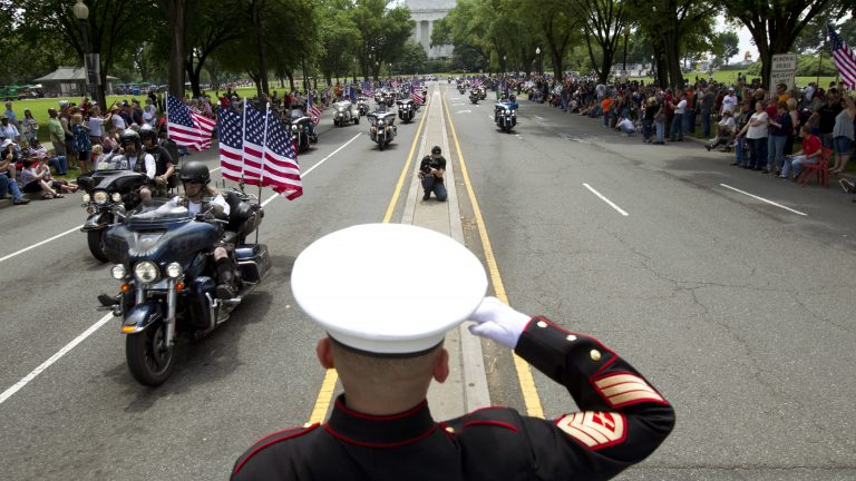 U.S. Marine Tim Chambers salutes to participants in last year's Rolling Thunder motorcycle demonstration. (Jose Luis Magana/AP)
