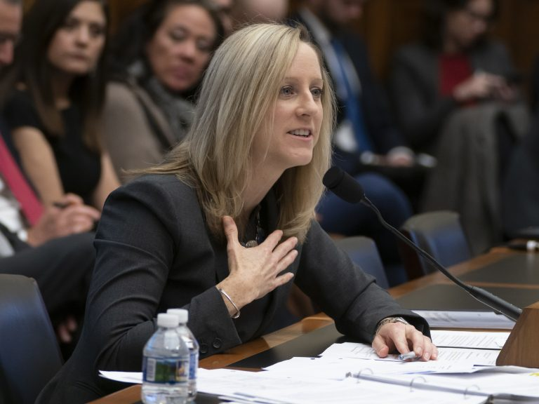 Kathy Kraninger, director of the Consumer Financial Protection Bureau, says in a letter that the Department of Education is getting in the way of efforts to police the student loan industry. (J. Scott Applewhite/AP)