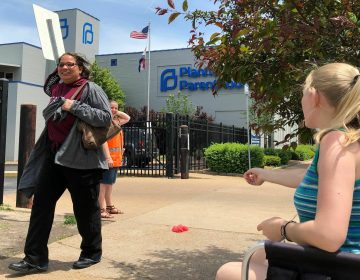 Teresa Pettis (right), an abortion opponent, protests outside the Planned Parenthood clinic in St. Louis, on May 17. Unless a judge intervenes, health officials will force a Missouri facility to stop offering the procedure this week. (Jim Salter/AP)