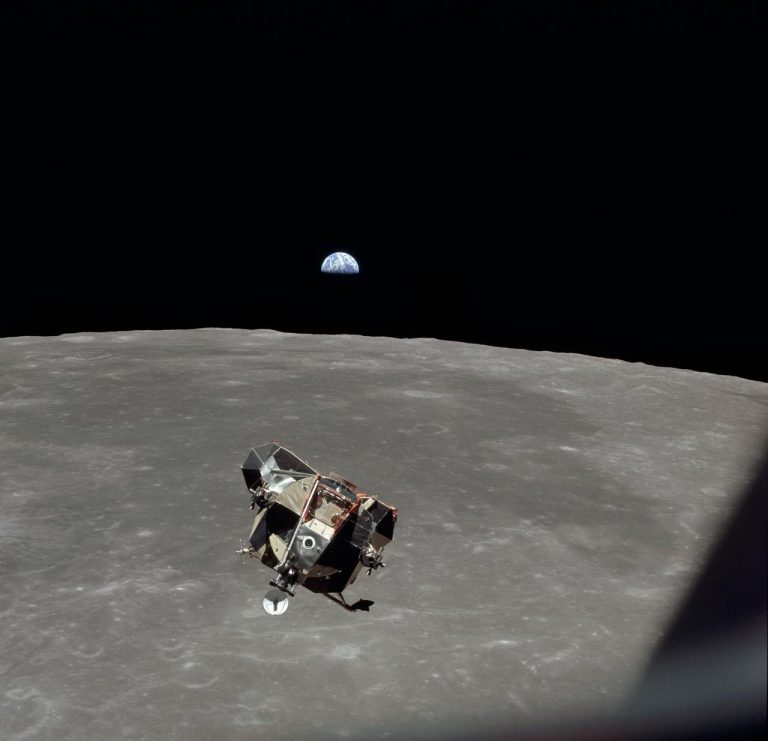 The Apollo 11 Lunar Module ascent stage in lunar orbit in 1969 with with astronauts Neil Armstrong and Buzz Aldrin aboard. The Earth rises above the lunar horizon. (Photo credit: NASA)