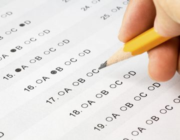 A student completes a multiple choice test. (AP Image)