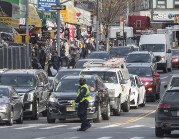 A police officer directs rush hour traffic on Canal Street in New York