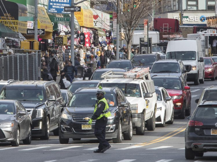 A police officer directs rush hour traffic on Canal Street in New York. (AP Photo/Mary Altaffer)
