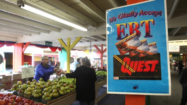 A sign announces the acceptance of electronic benefit transfer cards at a farmers market in California. (Rich Pedroncelli/AP)