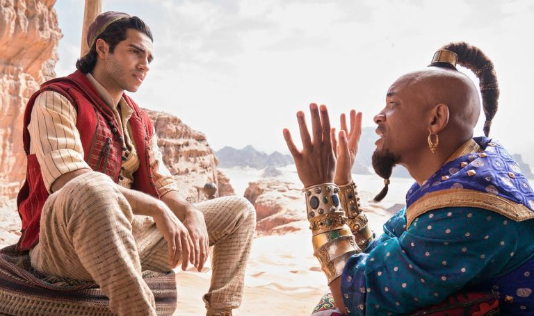 In the live-action 'Aladdin,' Mena Massoud stars Aladdin, while Will Smith plays the Genie.  Daniel Smith/Walt Disney Pictures