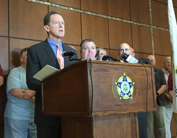 Pennsylvania Senator Pat Toomey has reintroduced the Thin Blue Line Act. Some say it will bring justice for slain cops. Others think it's an empty political gesture. (Avi Wolfman-Arent/WHYY)