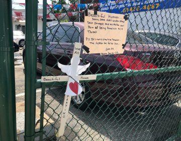 A fence near the scene of Monday night's shooting at G and Tioga streets holds tributes to Joel Johnson. Police have identified Detective Francis DiGiorgio as the shooter. (Nina Feldman/WHYY)