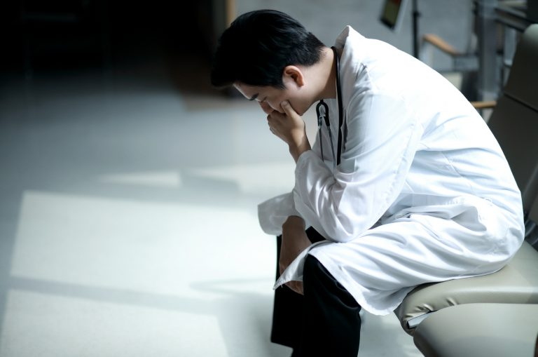 Doctors who experience burnout are prone to cut back on hours or quit practicing medicine. This costs the health care system billions, new research finds. (Runstudio/Getty Images)