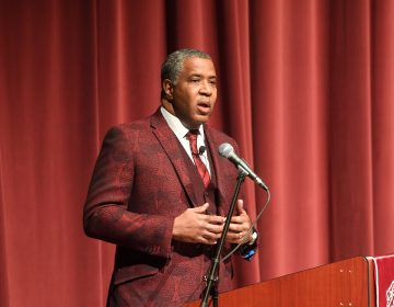 Robert F. Smith, founder, chairman and CEO of Vista Equity Partners, speaks at Morehouse College on Feb. 17, 2018 in Atlanta. Smith announced on Sunday he will pay off the student debt of the college's entire 2019 graduating class. (Getty Images)