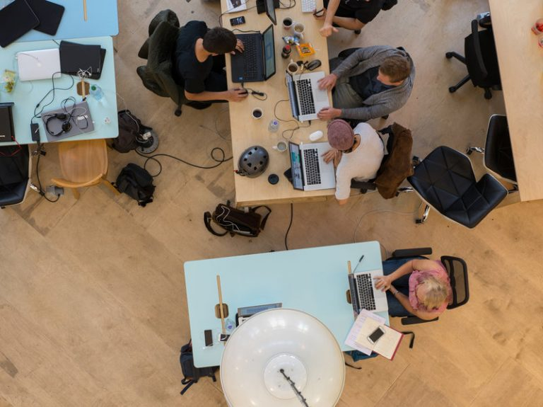 Above, an elevated view of start-ups in the Collective Temperance Hospital in London in 2016. (Lionel Derimais/Corbis via Getty Images)