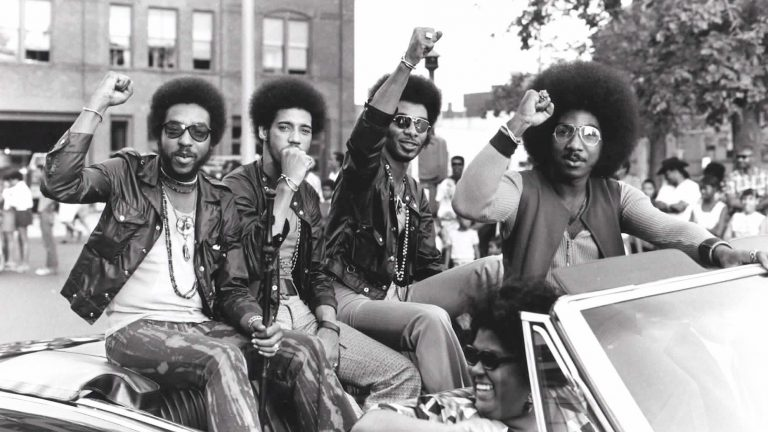 Members of the Nat Turner Rebellion ride in a parade during a Harambe Festival in Springfield, Mass., in the early 1970s. Pictured from left: Major Harris, Ron Hopper, Bill Stratley and Joe Jefferson (Courtesy of Reservoir Media)