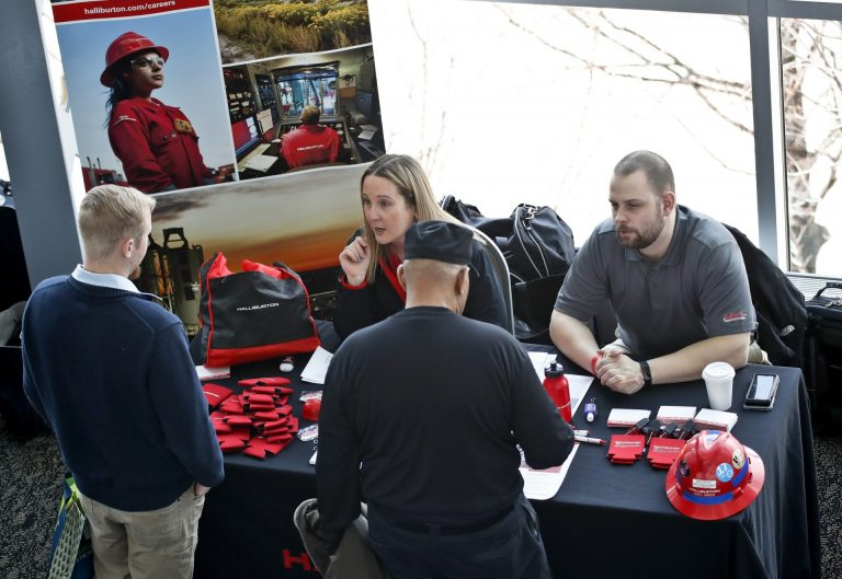 In this March 7, 2019, file photo visitors to the Pittsburgh veterans job fair meet with recruiters at Heinz Field in Pittsburgh. (Keith Srakocic/AP Photo)