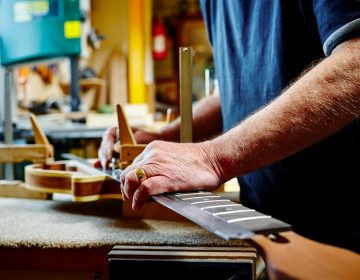 Having a purpose in life, whether building guitars or swimming or volunteer work, affects your health, researchers found. It even appeared to be more important for decreasing risk of death than exercising regularly. (Dean Mitchell/Getty Images)