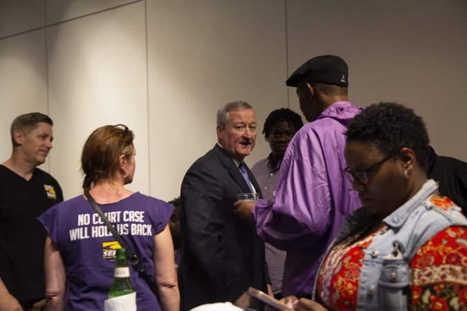 Philadelphia Mayor Jim Kenney greets supporters from SEIU at his campaign's party at the Jewish History museum Tuesday night. (Kimberly Paynter/WHYY)