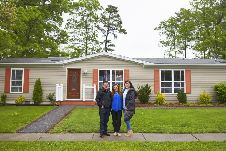 The Martinez family stands in front of their home in New Jersey. During a speech at her graduation, Alondra said to her parents: