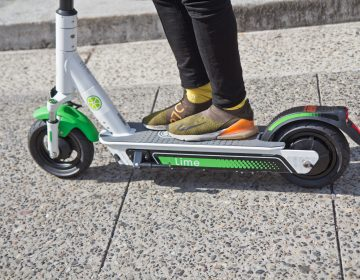 Riders were invited to test drive the Lime scooter at City Hall in Philadelphia. (Kimberly Paynter/WHYY)