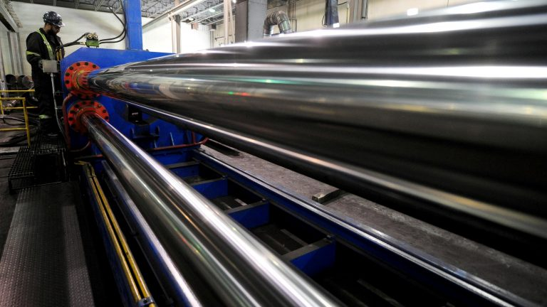 The U.S. is lifting tariffs on Canadian and Mexican steel imports, nearly a year after imposing the duties. Here, a worker is seen at Bri-Steel Manufacturing, which makes seamless steel pipes, in Edmonton, Alberta, Canada. (Candace Elliott/Reuters)