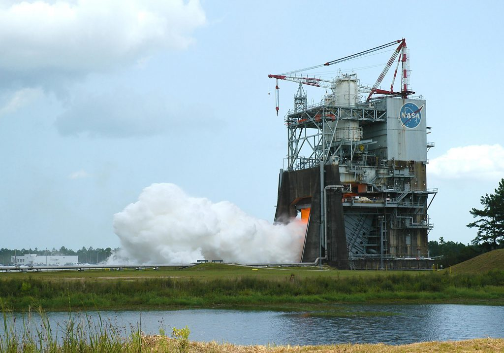 NASA conducts a successful hot fire test a rocket engine at the Stennis Space Center in Mississippi. Casey Dreier says NASA built it here partly because a senator from Mississippi was on the 1960s Senate appropriations committee. (Photo credit: NASA/SSC)