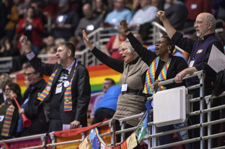 Protestors chant during the United Methodist Church's special session of the general conference in St. Louis, Tuesday, Feb. 26, 2019. America's second-largest Protestant denomination faces a likely fracture as delegates at the crucial meeting move to strengthen bans on same-sex marriage and ordination of LGBT clergy. (Sid Hastings/AP Photo)