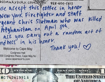 The postcard and $10 bill a customer handed to a Coffee Tyme employee in Cape May in honor of a fallen Marine. (Courtesy of Jesse Lambert/Coffee Tyme)