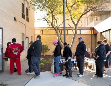 Voters line up outside the polls on Election Day in 2016 (WHYY, file)