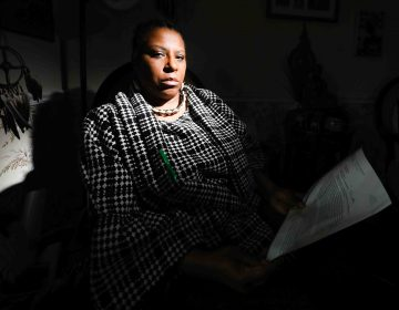 Former UD professor Arica Coleman in her home Wednesday. Feb. 27, 2019, in Newark, Del.  (Saquan Stimpson for WHYY)