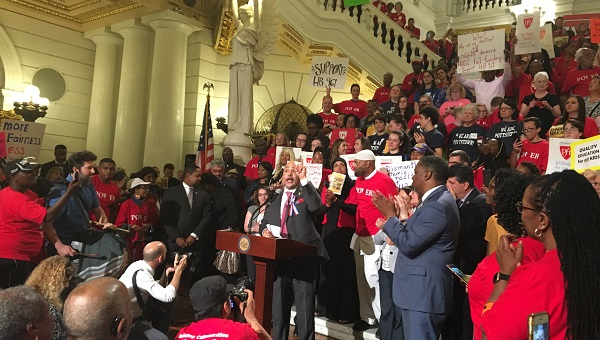 Philly Democrat Chris Rabb, who is sponsoring a bill to shift entirely to the Fair Funding formula, speaks at a rally. (Katie Meyer/WITF)