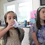 Emily Cutaiar, 8,  (left) and her sister Jessica, 9, know not to drink water from the tap in their Sellersville home. Their well was found to be contaminated with PFAS. (Emma Lee/WHYY)