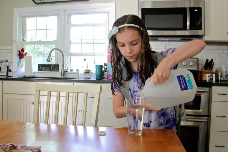 The Cutaiar family drinks only bottled water at their home in Sellersville, Pa. because the family's well was found to be contaminated with PFAS. (Emma Lee/WHYY)