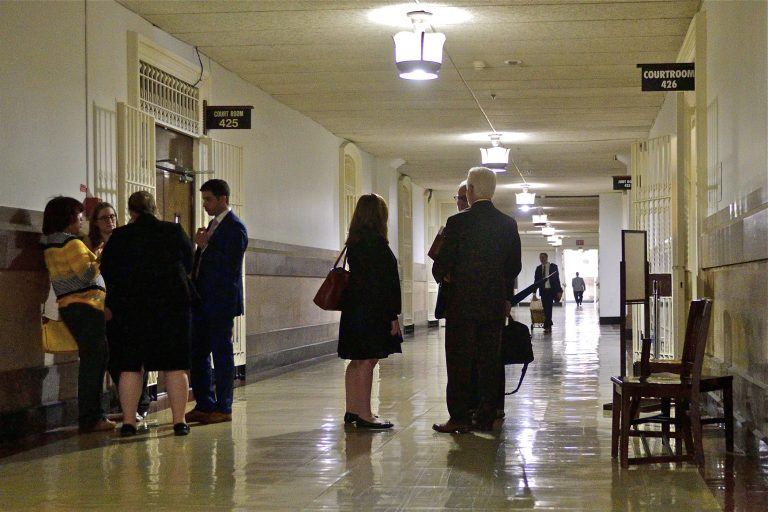 Lawyers gather in the hallway at Philadelphia City Hall that houses the First Judicial District of Pennsylvania. A computer virus has shut down the court's website. (Bastiaan Slabbers for WHYY)