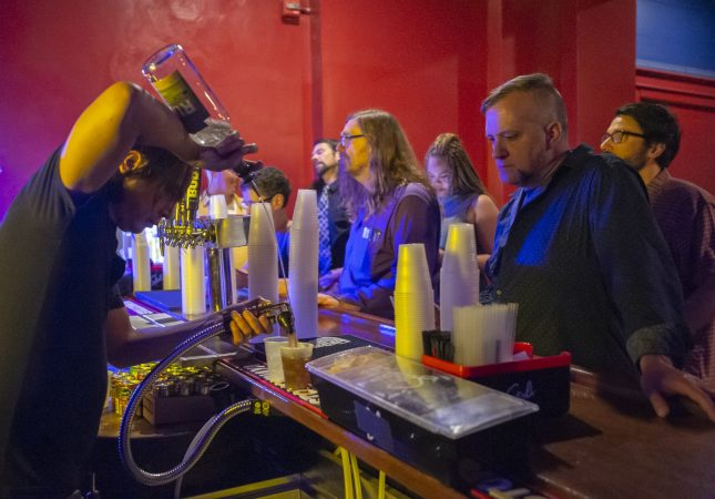 Troc fans line up at the bar prior to show time. (Jonathan Wilson for WHYY)
