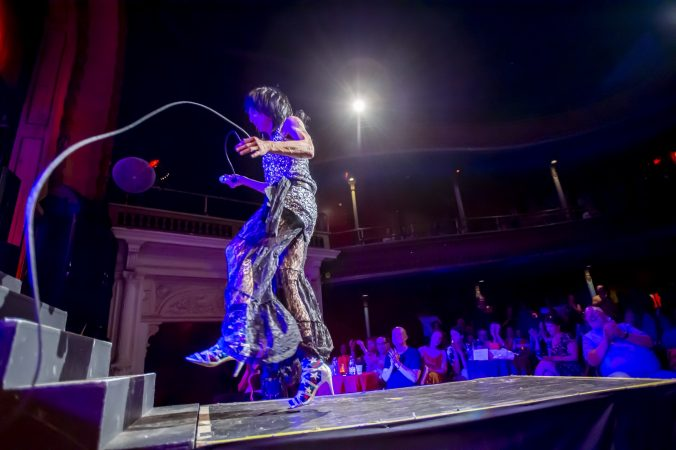 Helen Back prances around the stage and runway. (Jonathan Wilson for WHYY)