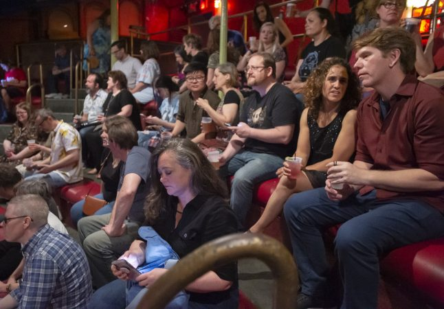 Audience members wait in the balcony for the show to begin. (Jonathan Wilson for WHYY)