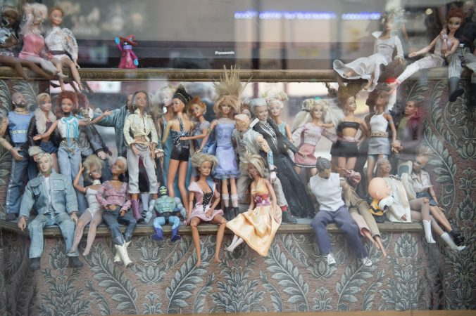In one of the Troc's windows is a collection of dolls dressed as performers. (Jonathan Wilson for WHYY)