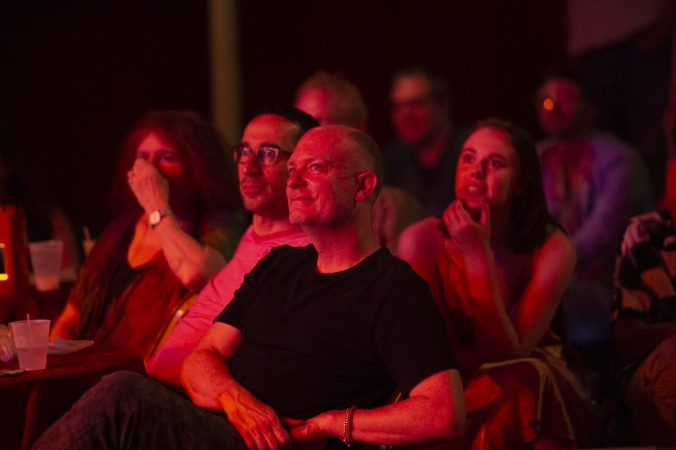Audience members watch The Big Mess Dancers. (Jonathan Wilson for WHYY)