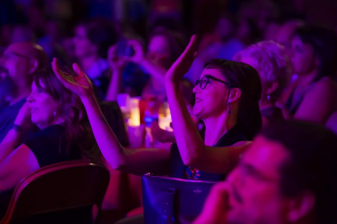 Lulu Lollipop who performed at the Troc in the past, applauds Lee Ann Etzold's satire of Mr. Rogers. (Jonathan Wilson for WHYY)