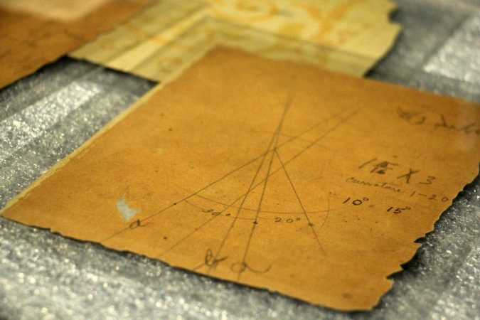 The Franklin Institute collection includes scraps of wallpaper on which the Wright Brothers made calculations and diagrams as they worked on their flying machine. (Emma Lee/WHYY)