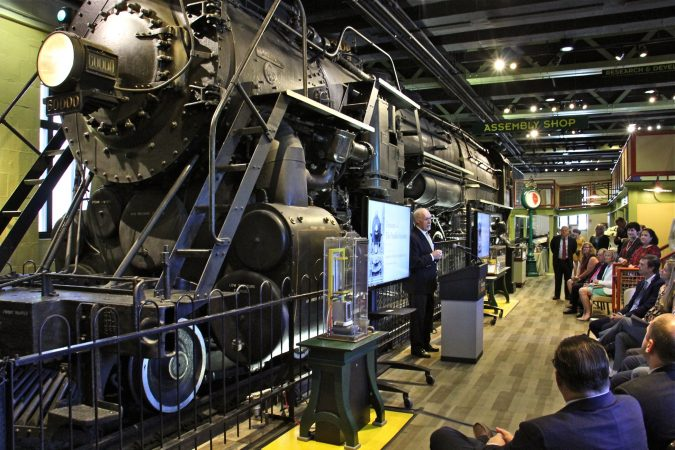 Donald E. Morel, Jr., chairman of the board of trustees of the Franklin Institute, announces that a $6 million gift from the Hamilton Family Charitable Trust will transfrom the iconic Train Factory exhibit into a an open curatorial space. (Emma Lee/WHYY)