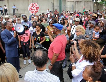 About 200 protesters gather at Philadelphia police headquarters to call for action against police officers who posted racist comments on Facebook. (Emma Lee/WHYY)