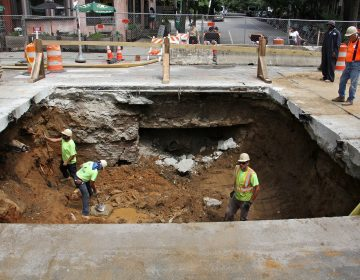 A sinkhole in Baltimore Avenue at 43rd Street was caused by a faulty sewer pipe. (Emma Lee/WHYY)