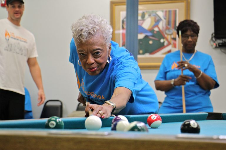 Mary Morris, 76, lines up her shot during the the Philadelphia Senior Games at West Oak Lane Senior Center. Morris, who has been playing pool since she was 12 years old, won her round against Pat Gathers, 77 (right)