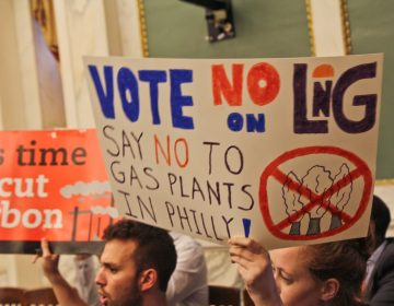 Opposition to the proposed liquefied natural gas plant in Philadelphia protest in city council chambers Thursday. (Kimberly Paynter/WHYY)