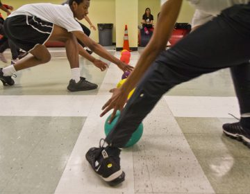 Students at Philadelphia's Constitution High School face off during dodgeball. (Kimberly Paynter/WHYY)