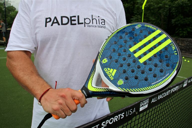 A padel racquet is a lightweight paddle strengthened with carbon and shot through with holes. Racquets like this one cost from $80 to $140. (Emma lee/WHYY)