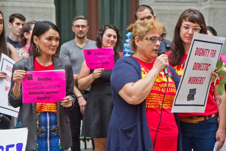 Activists, domestic workers, and government representatives gather outside City Hall Thursday morning before introducing the Domestic Workers'Bill of Rightslegislation to city council. (Kimberly Paynter/WHYY)