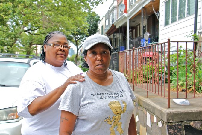 Kilynn Johnson (left) and Sonya Sanders, residents of South 32nd Street, are members of Philly Thrive, an organizations that opposes the expansion of Philadelphia Energy Solutions and blames the refinery for many of the neighborhood's health problems. (Emma Lee/WHYY)