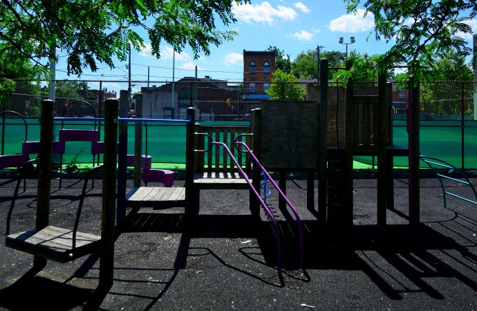 Parts of the school yard are fenced off, creating a separation between a dedicated area used by the school and one by the Belmont neighborhood community. (Bastiaan Slabbers for WHYY)