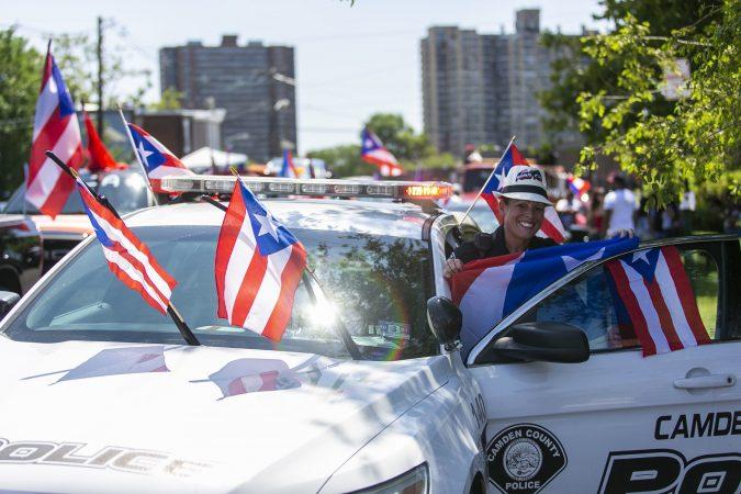 Belinda Villegas Ramos from Camden Metro Police participates in the San Juan Bautista parade. (Miguel Martinez/WHYY)